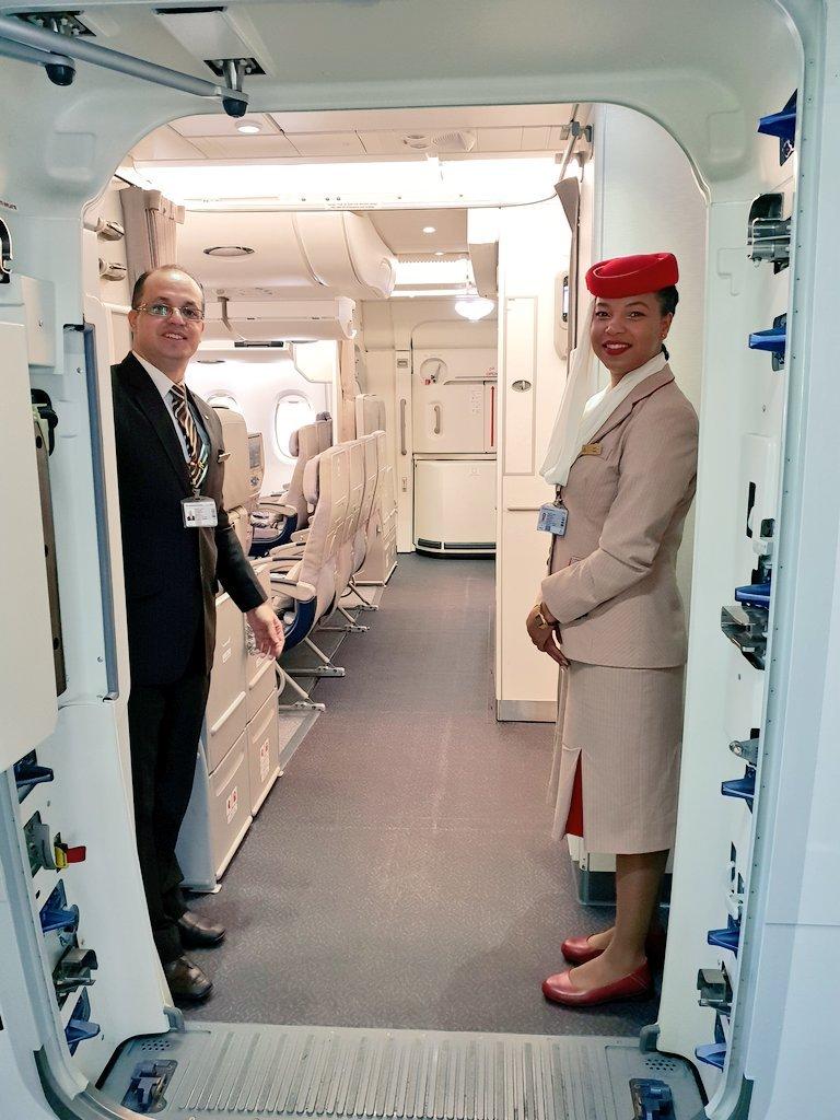 Emirates crew in A380 entrance door